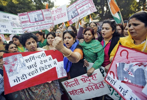 Members of All India Mahila Congress, women's wing of Congress party, shout slogans and carry placards during a protest against the rape of a female passenger, in New Delhi