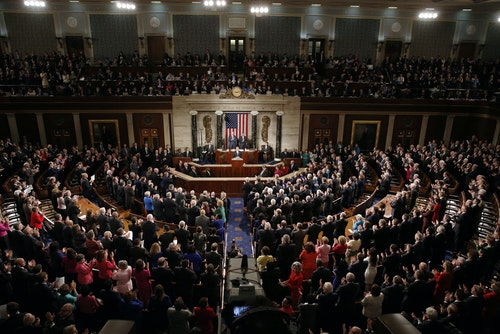 U.S. President Barack Obama receives a standing ovation as he delivers his State of the Union address to a joint session of Congress in the U.S. Capitol in Washington