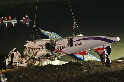 The wreckage of a TransAsia Airways aircraft is recovered from a river, in New Taipei City