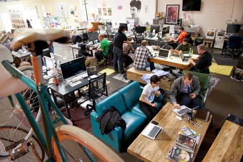 The office scene at a typical San Francisco start-up technology company in the Mission District.