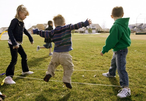 First grader Adam Kotzian plays a game with classmates during physical education at Eagleview Elementary school in Thornton
