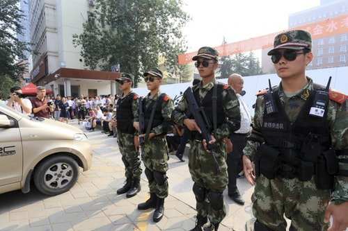 Armed police guard an exam site in Henan. Photo Credit: Reuters
