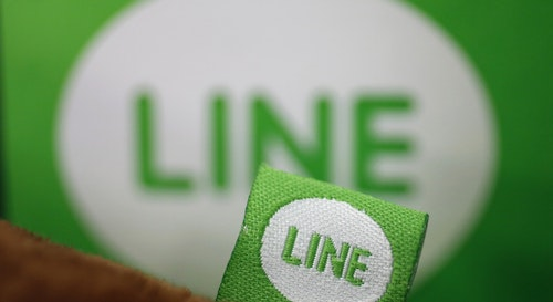 The logo of free messaging app Line is pictured on a smartphone and the company's stuffed toy in this photo illustration taken in Tokyo