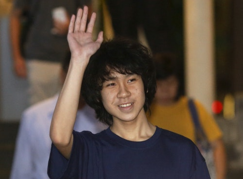 Amos Yee leaves the State Court after his trial in Singapore