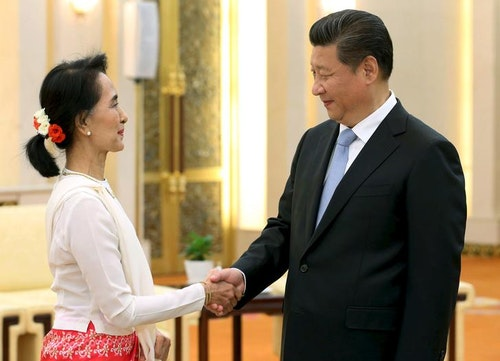 China's President Xi shakes hands with Myanmar pro-democracy leader Aung San Suu Kyi during meeting at Great Hall of People in Beijing