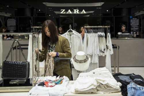 A woman browses for clothes inside Asia's largest Zara flagship store in Hong Kong
