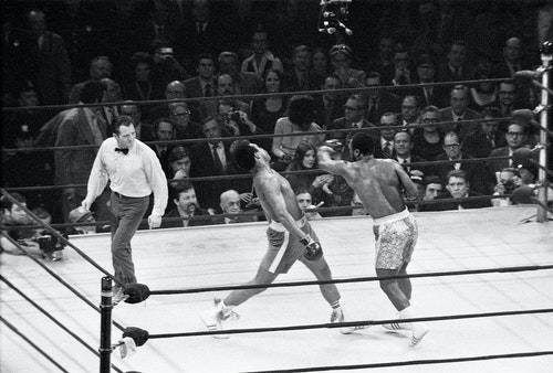 Joe Frazier (R) lands a left hook on Muhammad Ali during the first of their three epic battles at Madison Square Garden in New York City