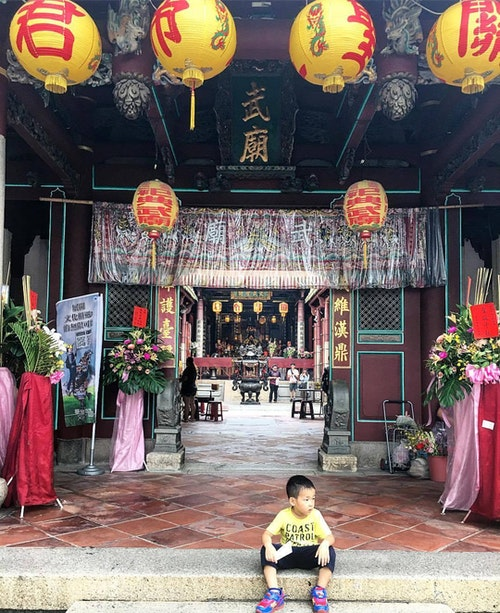 A boy outside a temple in Tainan
