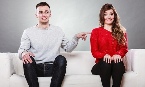 Shy_woman_and_man_sitting_on_sofa_couch_