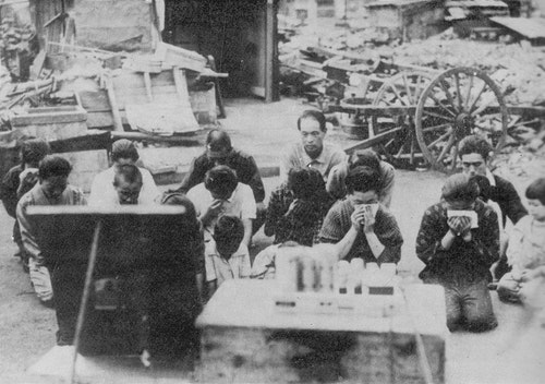 1535px-Japanese_civilians_listening_to_t